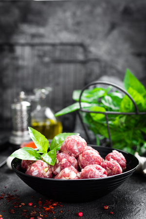 Beef meatballs. Cooking raw beef meatballs Stockfoto
