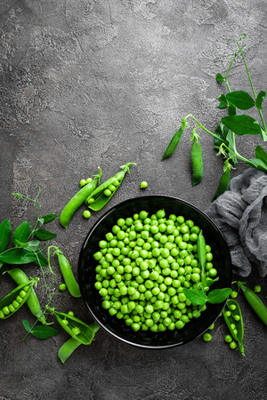 Green peas with pods and leaves