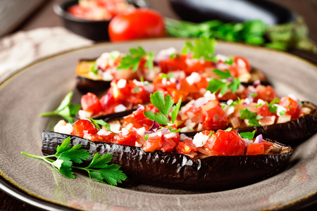 Baked eggplants with tomatoes, onion and garlic Stock Photo