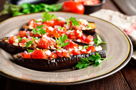 Baked eggplants with tomatoes, onion and garlic 스톡 콘텐츠