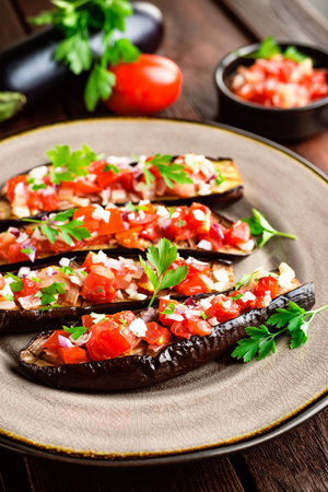 Baked eggplants with tomatoes, onion and garlic Reklamní fotografie