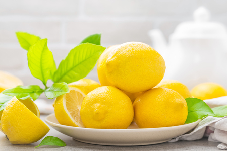 Fresh lemons with lemon leaves