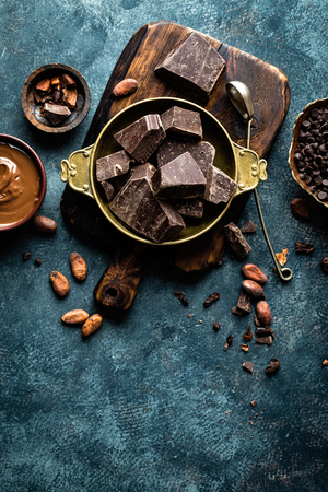 Dark chocolate pieces crushed and cocoa beans. Chocolate background 写真素材