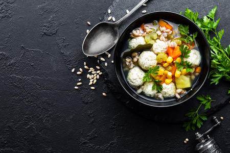 Delicious vegetable soup with chicken meatballs and pearl barley Фото со стока - 109105253