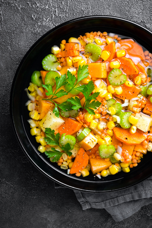 Healthy vegetarian vegetable soup with lentil and vegetables. Lentil soup with vegetables Фото со стока - 109947880