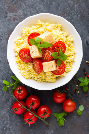 Millet porridge with tomatoes and cheese Zdjęcie Seryjne