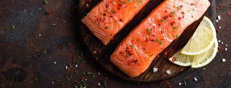 Fresh salmon fish fillet on wooden board