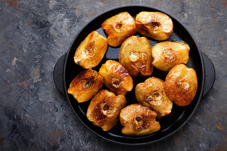 Apple quince baked with honey and cinnamon. Healthy vegetarian dessert Reklamní fotografie
