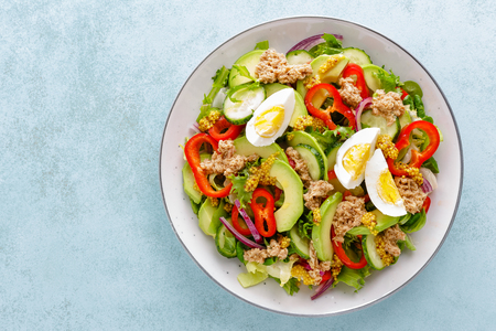 Tuna salad with boiled egg and fresh vegetables. Healthy diet food. Greek cuisine. Top view