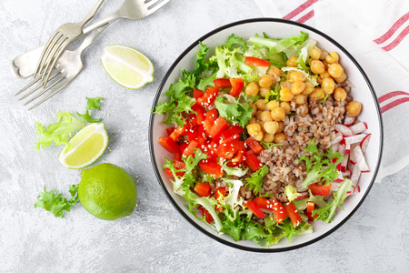 Healthy and delicious bowl with buckwheat and salad of chickpea, fresh pepper and lettuce leaves. Dietary balanced plant-based food. Vegan and vegetarian dish. Top view. Flat lay Stock Photo - 114361177