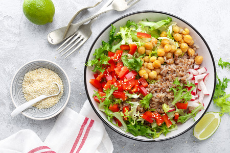 Healthy and delicious bowl with buckwheat and salad of chickpea, fresh pepper and lettuce leaves. Dietary balanced plant-based food. Vegan and vegetarian dish. Top view. Flat lay Stock Photo - 114361656