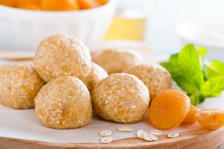 Oat balls with honey, apricot and banana, healthy vegan dessert