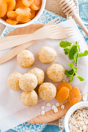 Oat balls with honey, apricot and banana, healthy vegan dessert