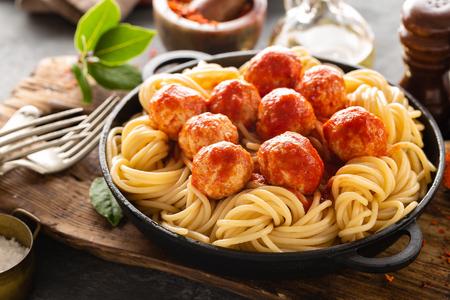 Spaghetti with tomato sauce and meatballs Фото со стока