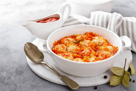 Fish meatballs in tomato sauce with carrot Stock Photo