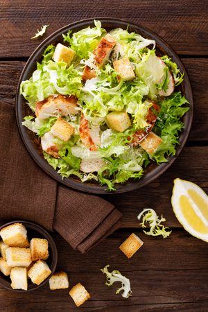 Caesar salad with grilled chicken meat, fresh lettuce, parmesan cheese and fried croutons.