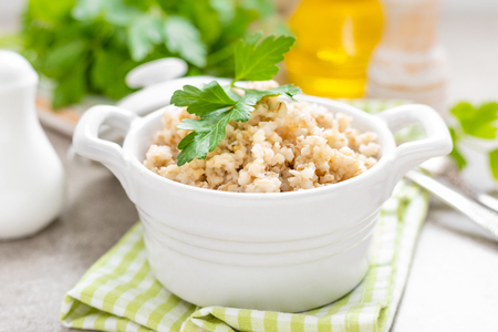 Barley porridge on white background
