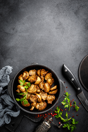 Fried mushrooms, champignons in pan