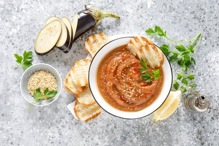 Eggplant hummus with ingredients for cooking. Traditional vegan arabic aubergine appetizer. Baba Ghanoush