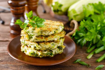 Vegetable fritters with zucchini and greens Фото со стока - 128906190