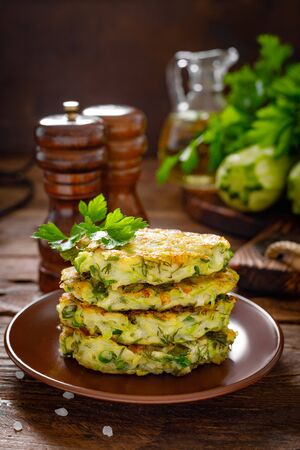 Vegetable fritters with zucchini and greens Фото со стока - 128906197