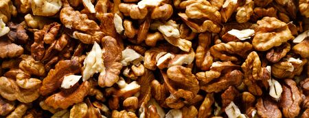 Walnuts. Kernels nuts banner background, top view