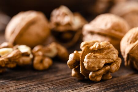 Walnuts. Kernels and whole nuts on wooden rustic table Stock fotó