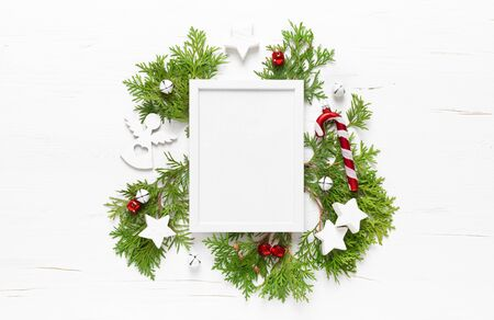 Christmas, New Year or Noel holiday festive winter greeting card with decorations, frame, x-mas ornaments, stars and xmas bells on white background, flat lay composition, top view
