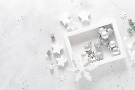 Christmas, New Year or Noel holiday festive decorations, ornaments - balls, snowflakes, stars, deer, bells and balls on white background, flat lay composition, greeting Xmas card, top view