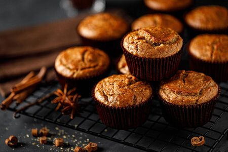 Cinnamon muffins on black background