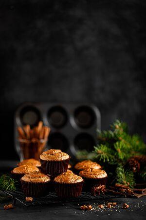 Christmas cinnamon muffins on black background 스톡 콘텐츠