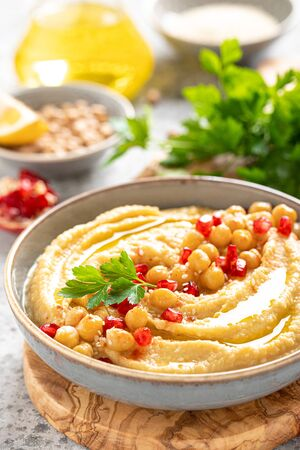 Chickpea hummus with tahini in a bowl. Healthy vegetarian appetizer. Middle Eastern cuisine Stok Fotoğraf - 133865247