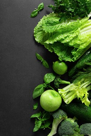 Healthy food, fresh raw green organic fruits and leafy vegetables, clean eating, vegetarian food concept background, top view
