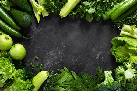 Healthy food, fresh raw green organic fruits and vegetables, clean eating, vegetarian food concept background, top view Reklamní fotografie