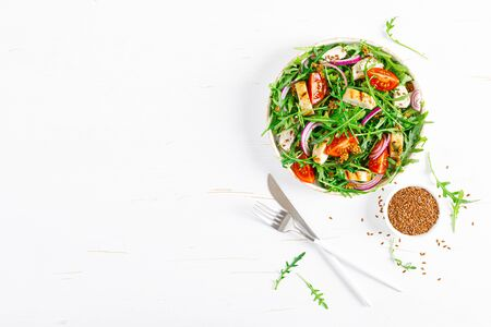 Fresh vegetable salad with grilled chicken fillet, breast, tomato and arugula, top view Banco de Imagens