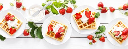 Traditional belgian waffles with cream cheese and fresh strawberry on white background, banner Stockfoto