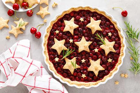Homemade cherry pie, tart with star shaped cookies