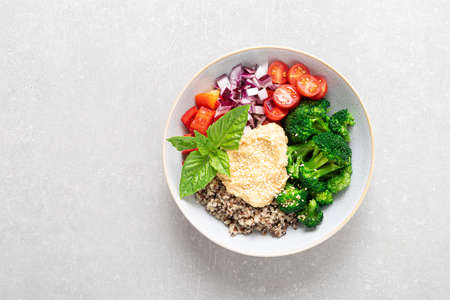 Vegetarian Buddha bowl with quinoa, vegetables and hummus, healthy food concept