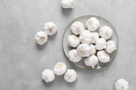 Fresh whole garlic bulbs, top down view