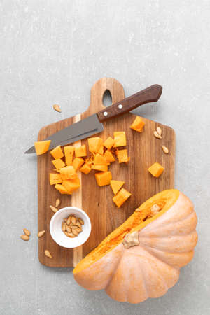 Fresh raw sliced butternut squash on wooden board, copy space for text, top down view