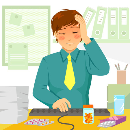 headache: young man feeling ill at work