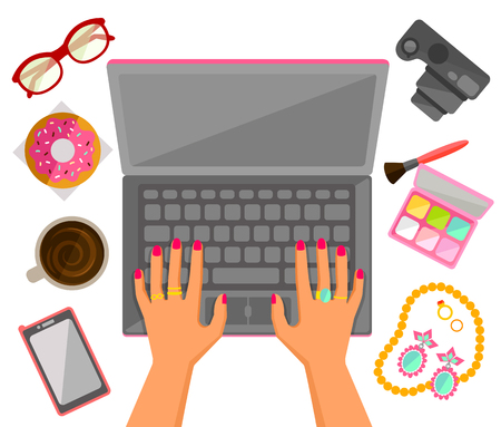 hands on keyboard: Female hands typing on a laptop with trendy items around