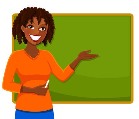 happy teacher of African ethnicity standing next to a blackboard