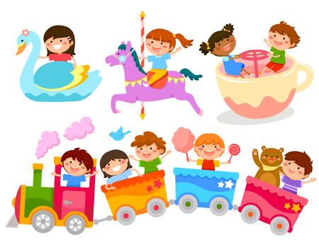 having fun: happy kids having fun on amusement park rides