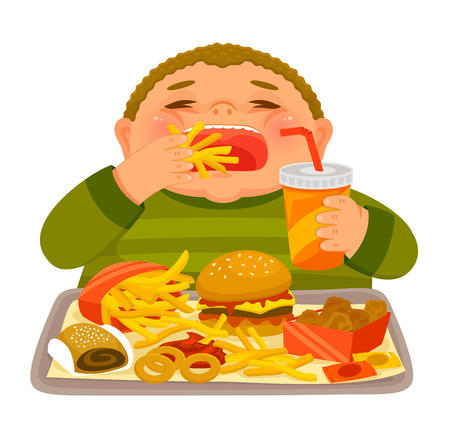 Overweight boy mindlessly eating large amounts of junk food