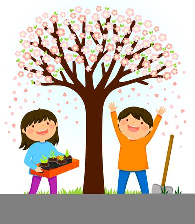 ツ・ビシュヴァットの苗木を植える準備をしている咲く木の下に立つ子供たち