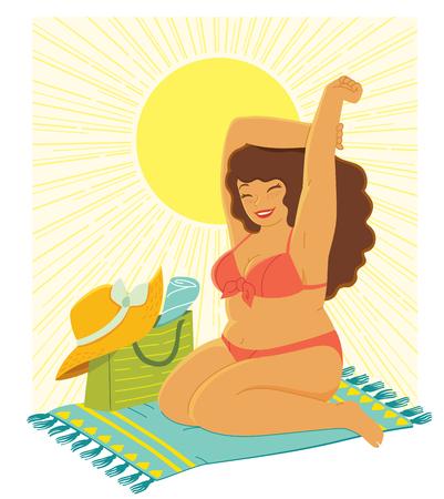 Beautiful curvy woman in a bikini enjoying the sun at the beach
