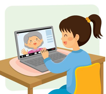 Little girl having a video chat with her grandmother online from distance