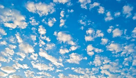 Gentle clouds in the blue sky illuminated by the sun Stock Photo - 6204705