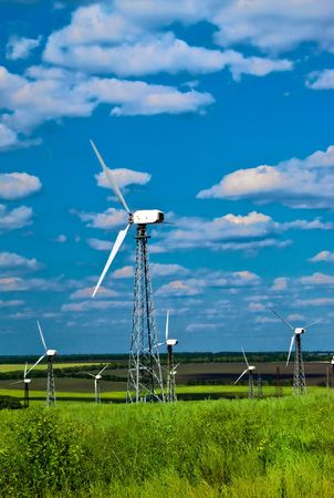 Wind power station - wind turbines against the blue sky and a green grass Stock Photo - 6265853